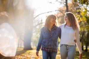 two women embracing hiking at medical detox center Oklahoma