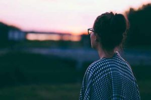 woman watching sunset at residential addiction treatment center Oklahoma