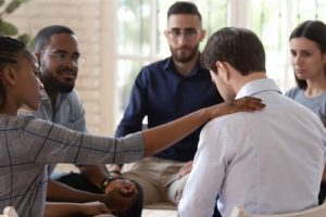 individual in group therapy at Benzo Addiction Treatment Center