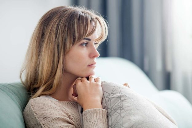woman on couch knowing Alcohol is a Drug